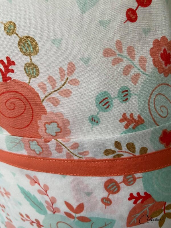 Shop Wyoming Coral and mint floral and glitzy gold apron