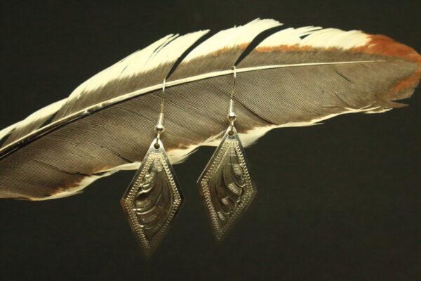 Shop Wyoming Diamond shaped, hand engraved pendant earrings.