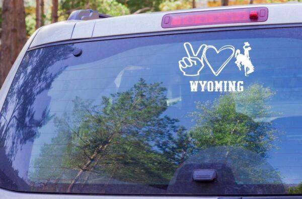 Shop Wyoming Peace Love Wyoming Bucking Cowboy Decal